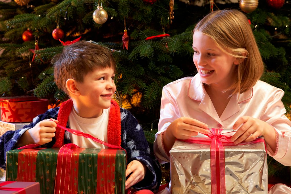Children opening wrapped toys at Chrismas