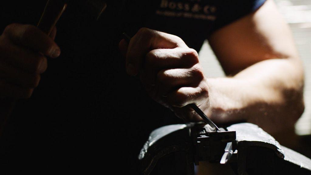 Hand engraving a gun