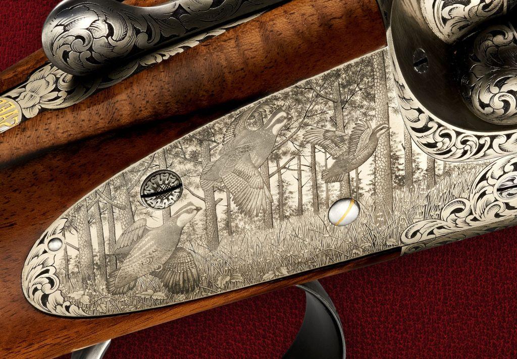 Hand engraved scene on a bespoke made gun