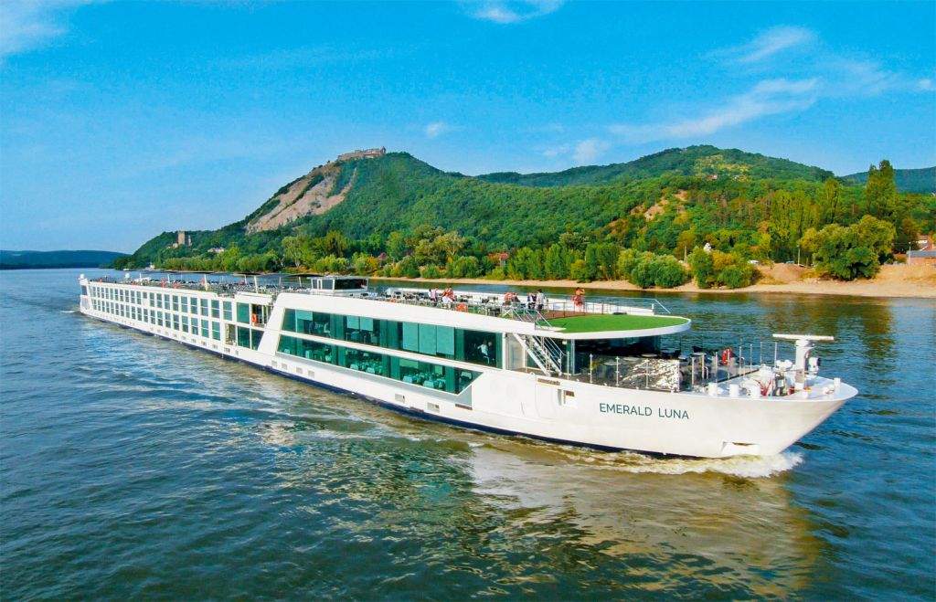 The Emerald Luna cruising along a river