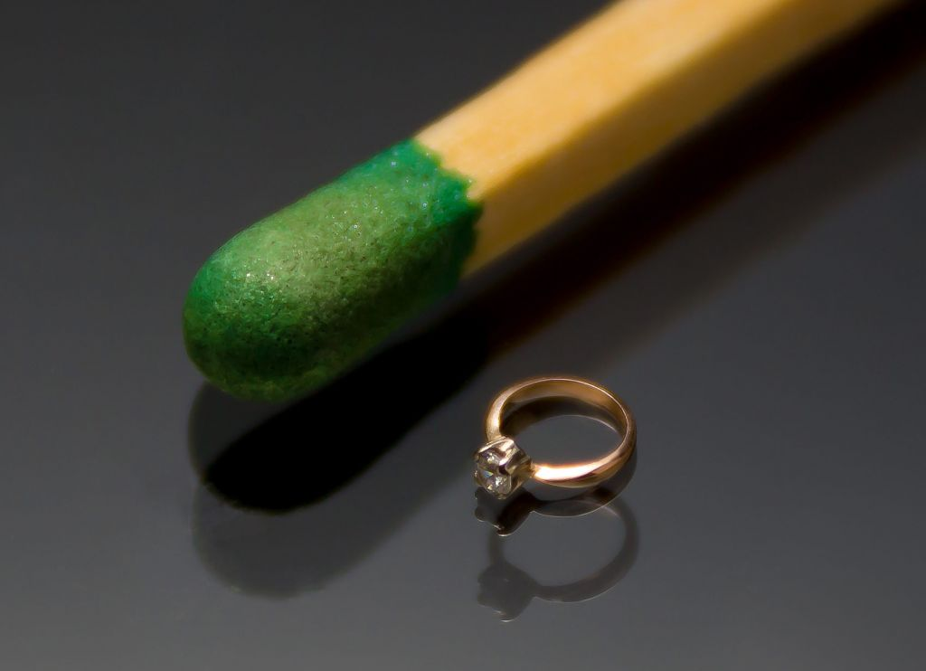 The smallest diamond ring in the world next to the head of a match