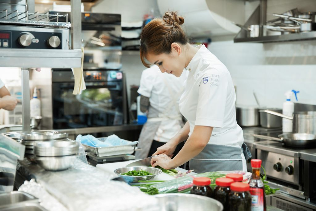 Chef Vicky Lau cooking in the TATE Dining Room in Hong Kong