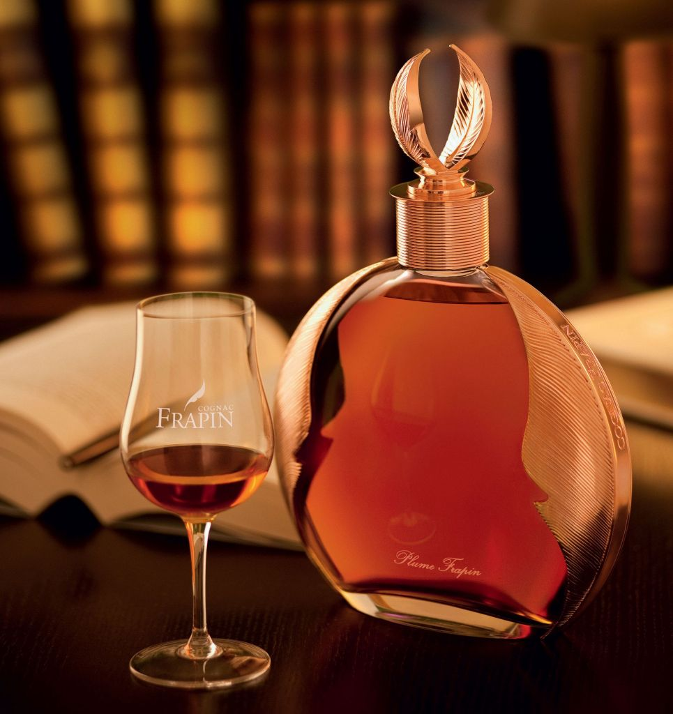 Decanter and a glass of Plume by Frapin