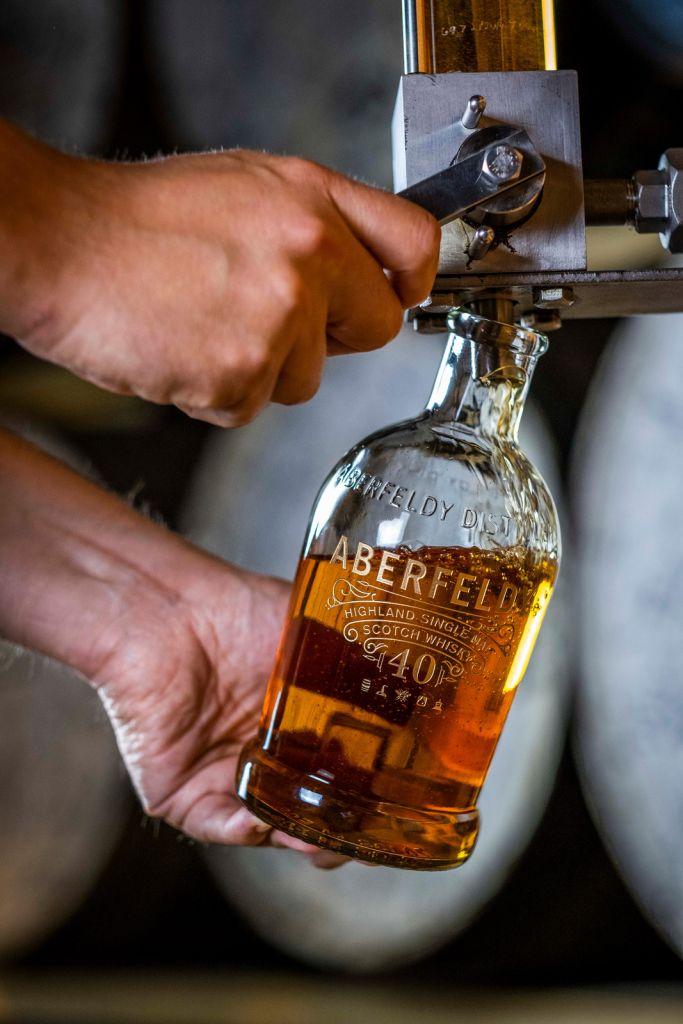 Hand-filling a bottle of Aberfeldy 40-Year-Old.