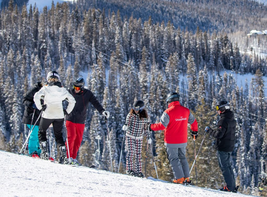 People on snowy slope learning to ski