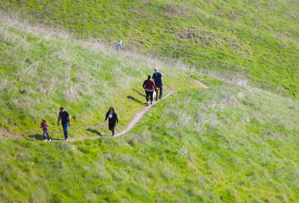 People walking the trails on the Pismo Preserve