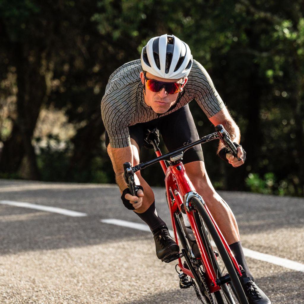 Male rider in a Velocio Ultra-light jersey