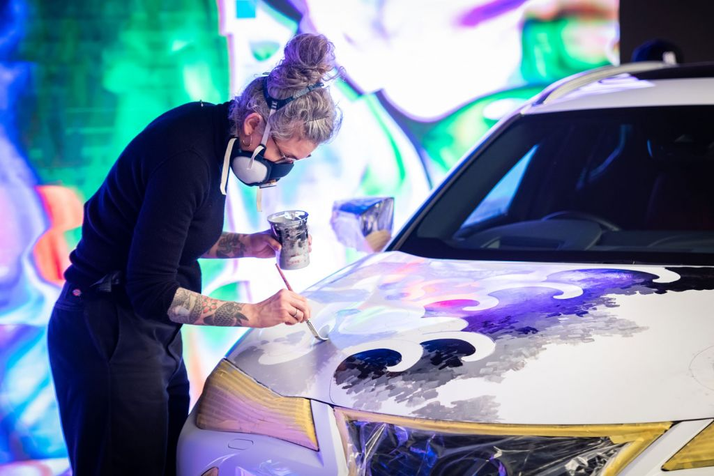 Painting a tattoo on a car
