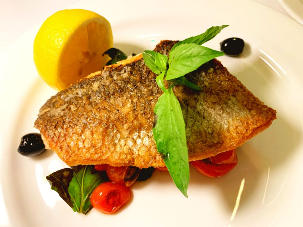 Mediterranean-style grilled fillet of sea bass at MAIA In Knightsbridge
