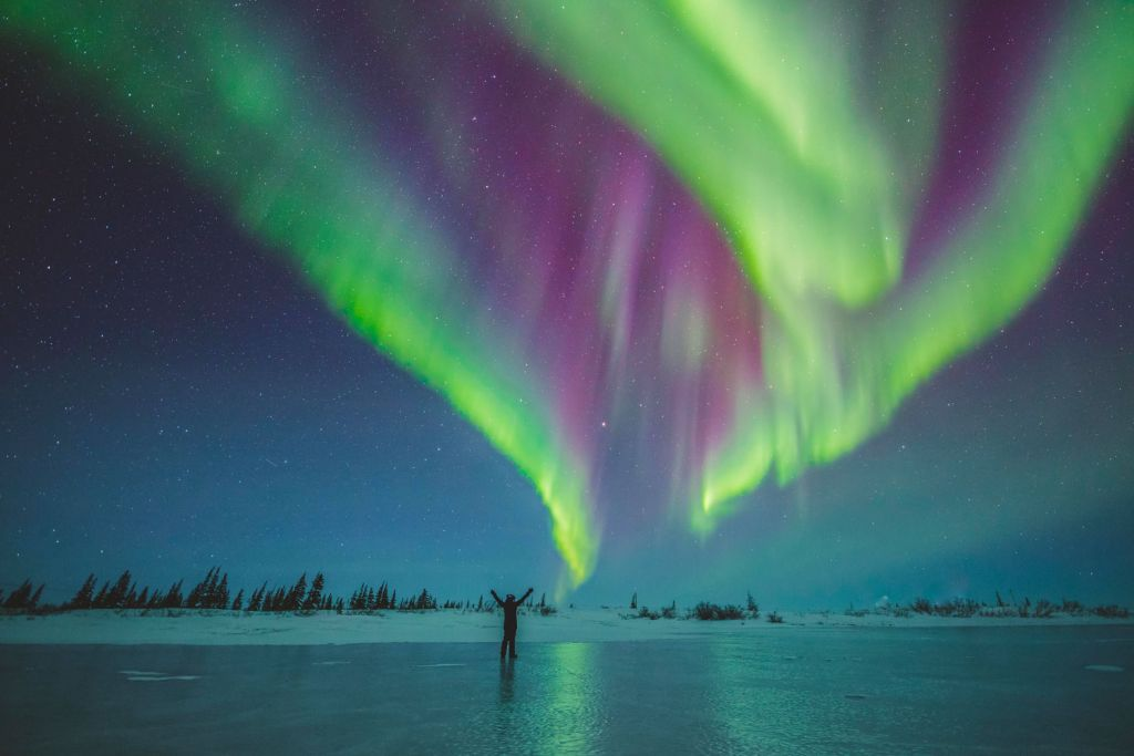 Watching the Northern Lights on a frozen lake in Manitoba