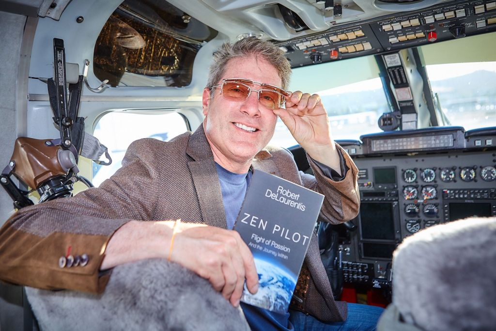 """""""Peace Pilot"""" Robert DeLaurentis with his book Zen Pilot"""