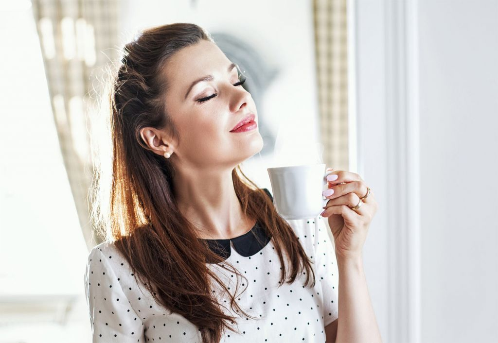 A woman drinking the perfect cup of tea