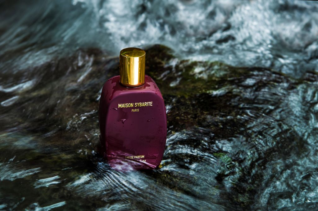 Maison Sybarite perfume bottle washed by water