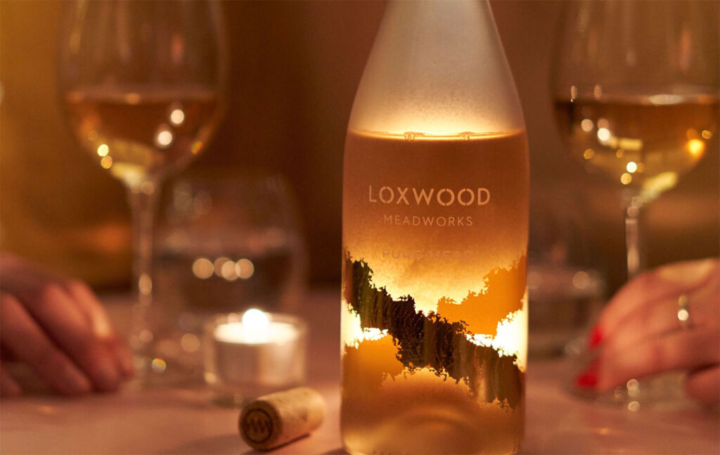 A couple enjoying Loxwood Meadworks Pure Mead