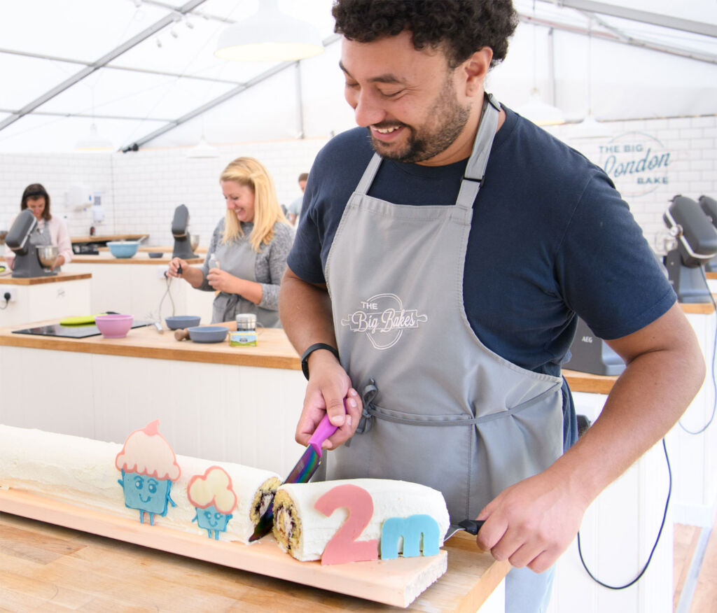 Adam Chaudri cutting the cake at The Big Bake