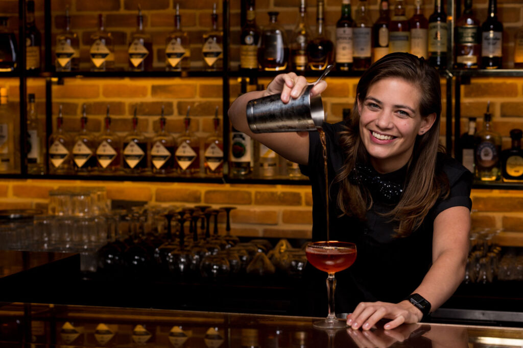 Tess Posthumus behind the bar