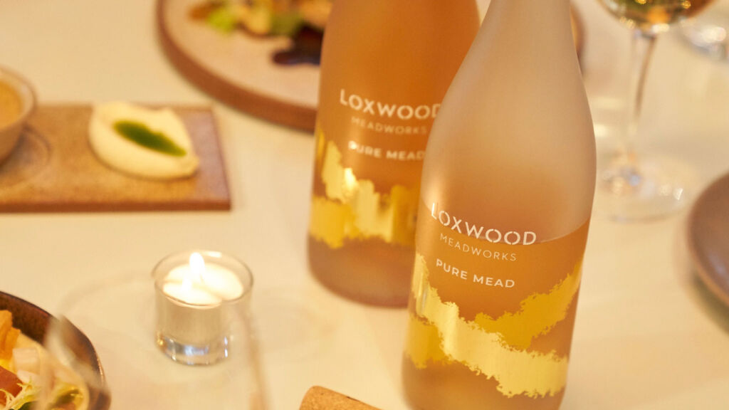 Bottles of Loxwood Meadworks Pure Mead on table