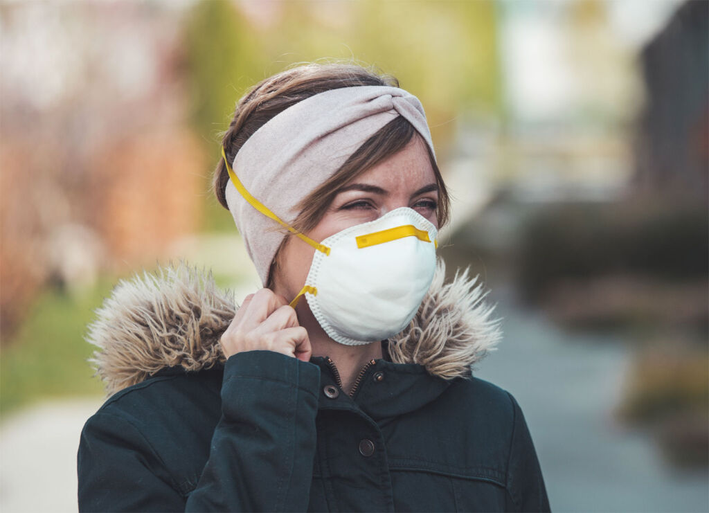 Woman heading to the shops in a face mask