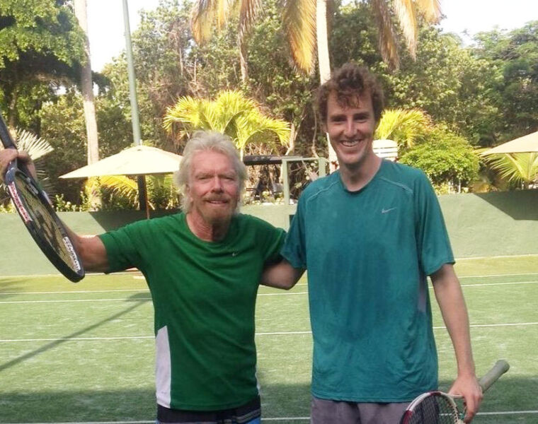 Richard Branson taking tennis lessons from James Cluskey