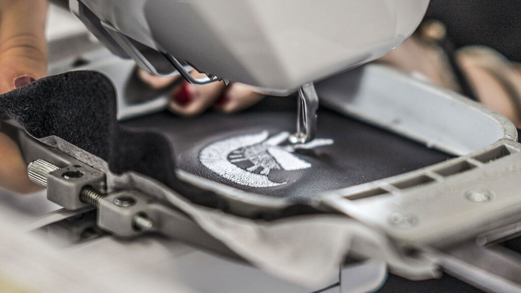 Stitching the ARES Design Logo into leather