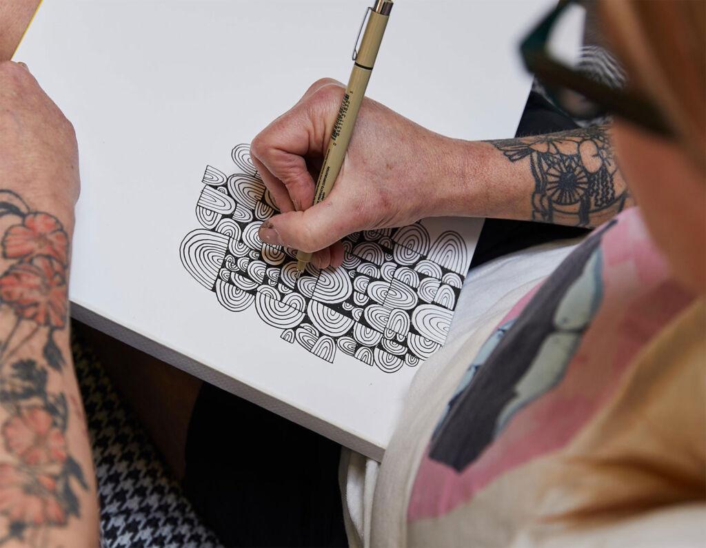 The artist Lisa Congdon designing
