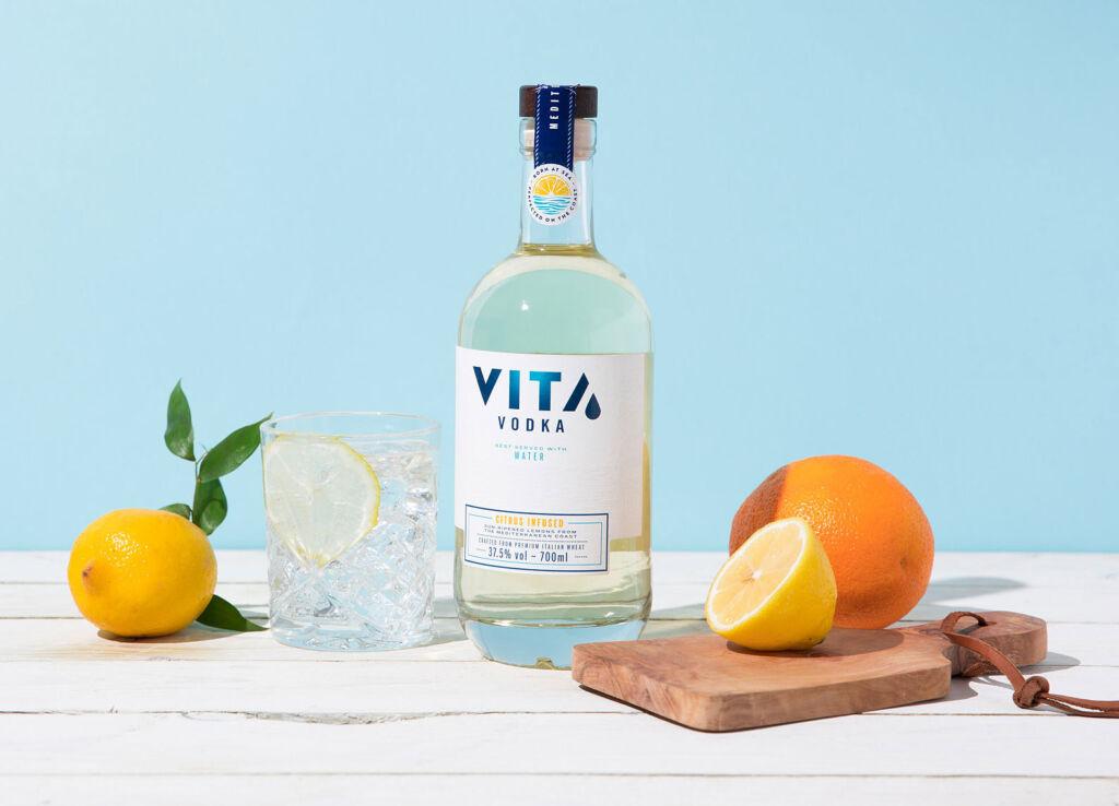 VITA Vodka on table with fruit
