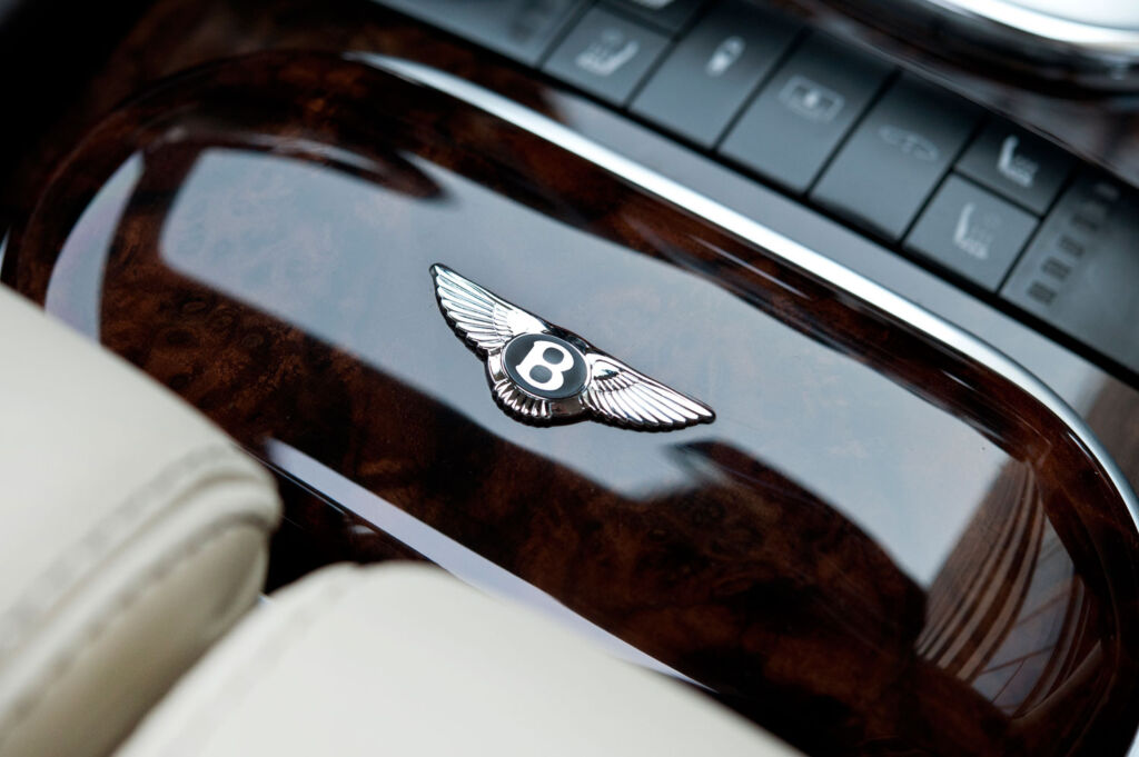 Bentley Flying Spur badge on walnut
