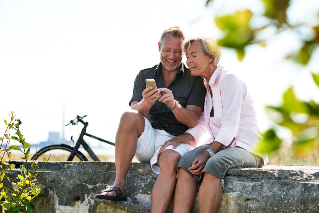 Couple looking at photographs on a phone