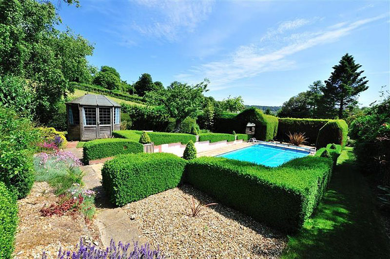 An English garden with a swimming pool