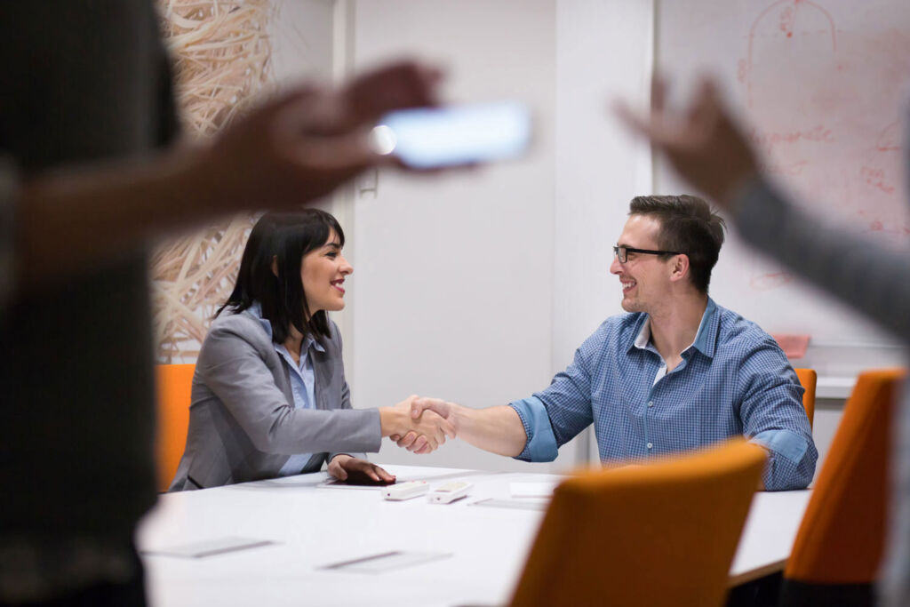 Man and woman shaking hands on a property deal