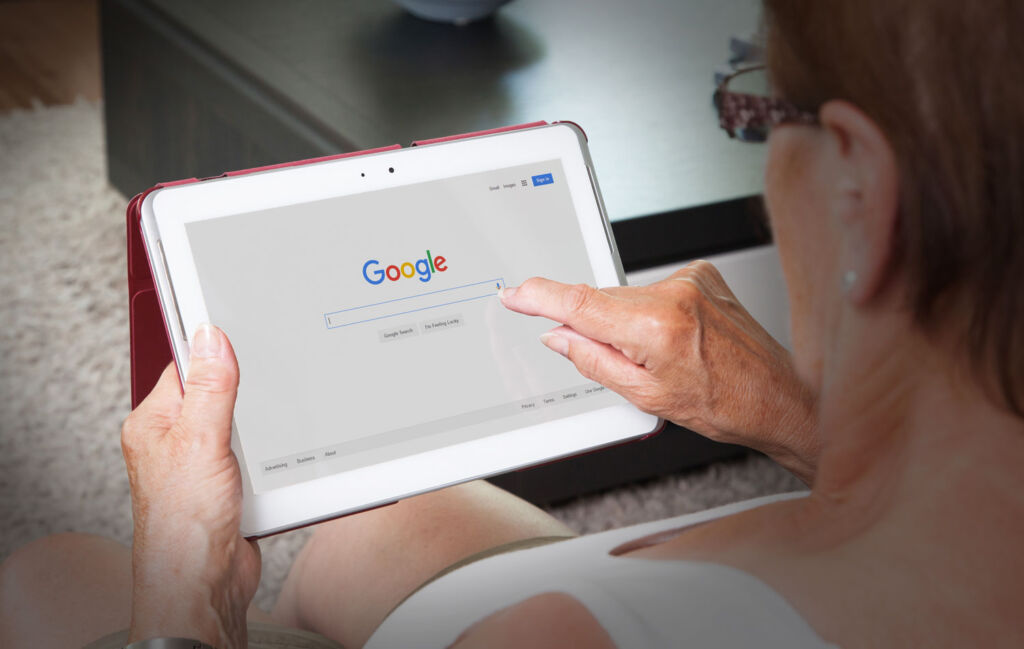 Woman using Google search on tablet
