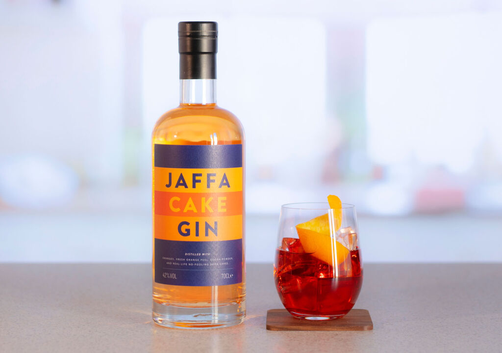 Bottle of Jaffa Cake Gin with a cocktail glass