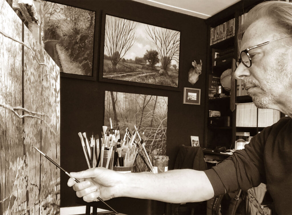 Jaques Gregoire painting in his studio