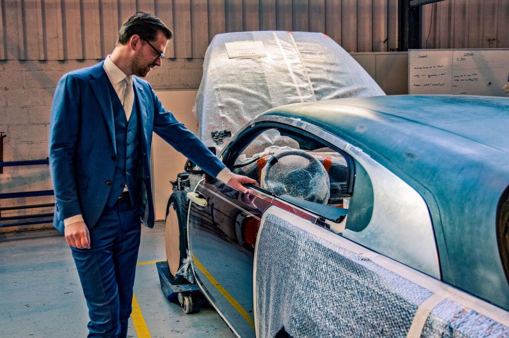 Niels van Roij inspecting the Silver Spectre Shooting Brake
