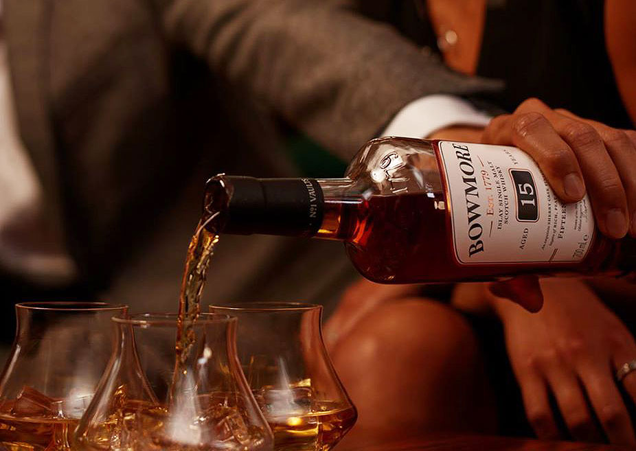 Pouring a bottle of Bowmore 15 year old