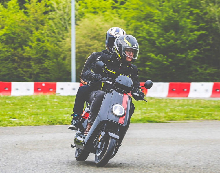 Rider and passenger on the NQi GTS Sport