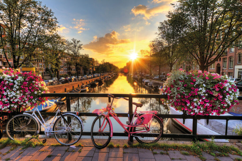 Man and womans bicycle on a bridge in Holland