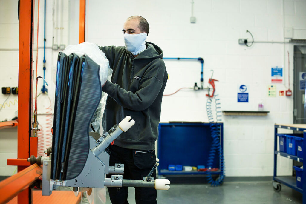 Samuel Walker working in the Caribbean Blinds UK Factory