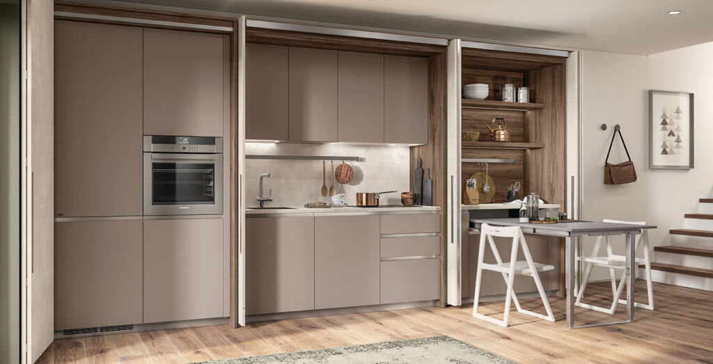 The kitchen area offers ample storage and all modern conveniences