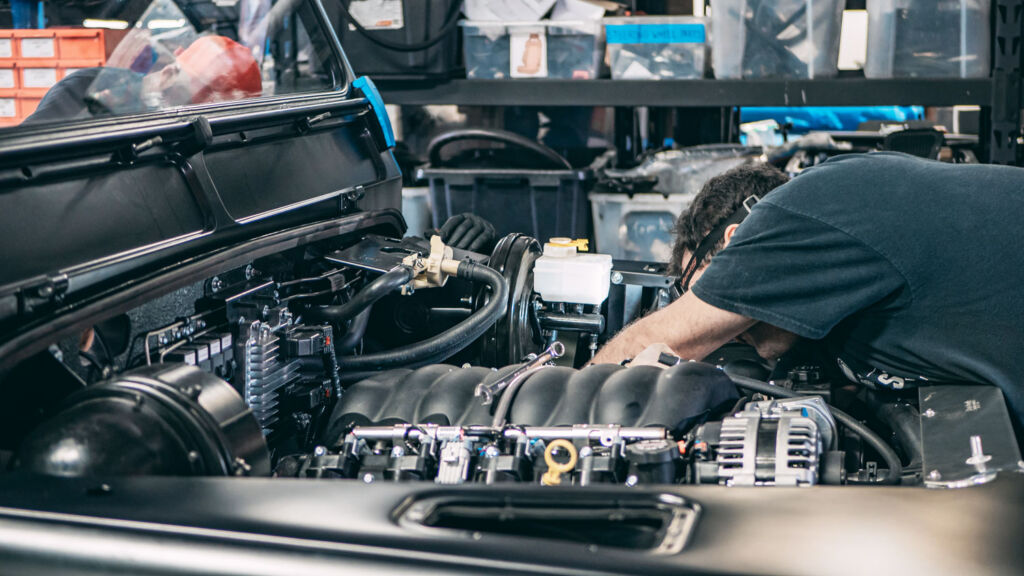The team Working on an E.C.D Automotive engine