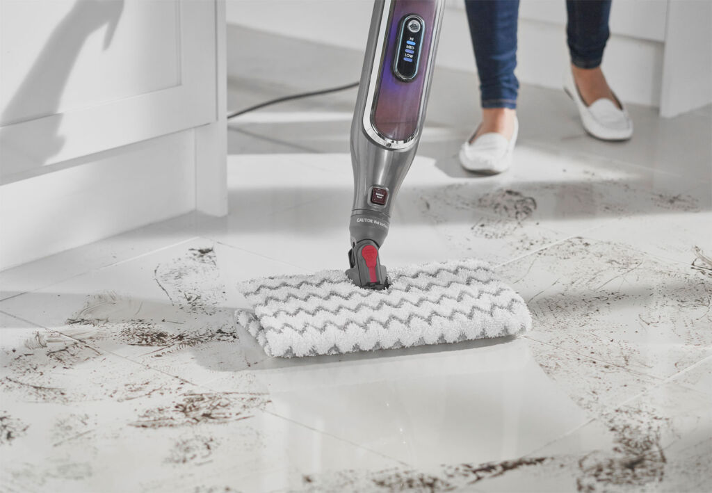 Cleaning muddy tiled floor with steam mop