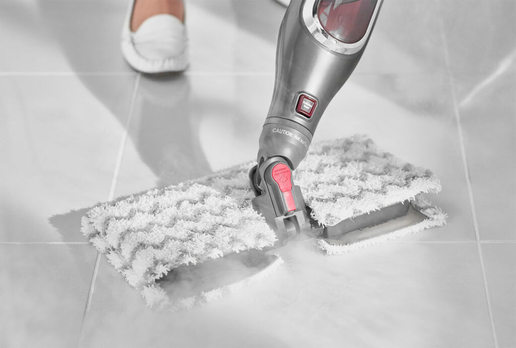 Steam mop head cleaning tiles