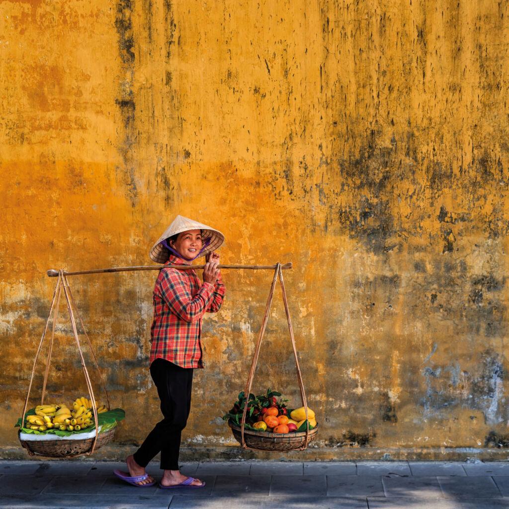 Elderly lady selling produce in Vietnam