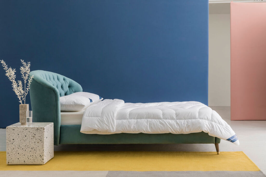 Brook + Wilde Everdene Cooling pillow and quilt on a bed