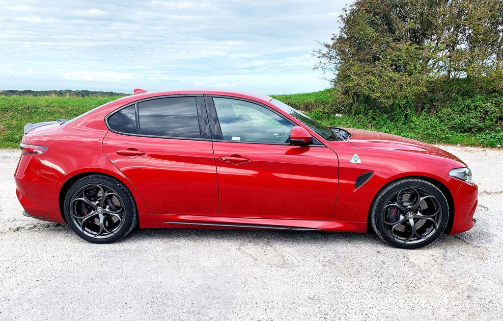 2020 Alfa Romeo Giulia Quadrifoglio side profile in the countryside