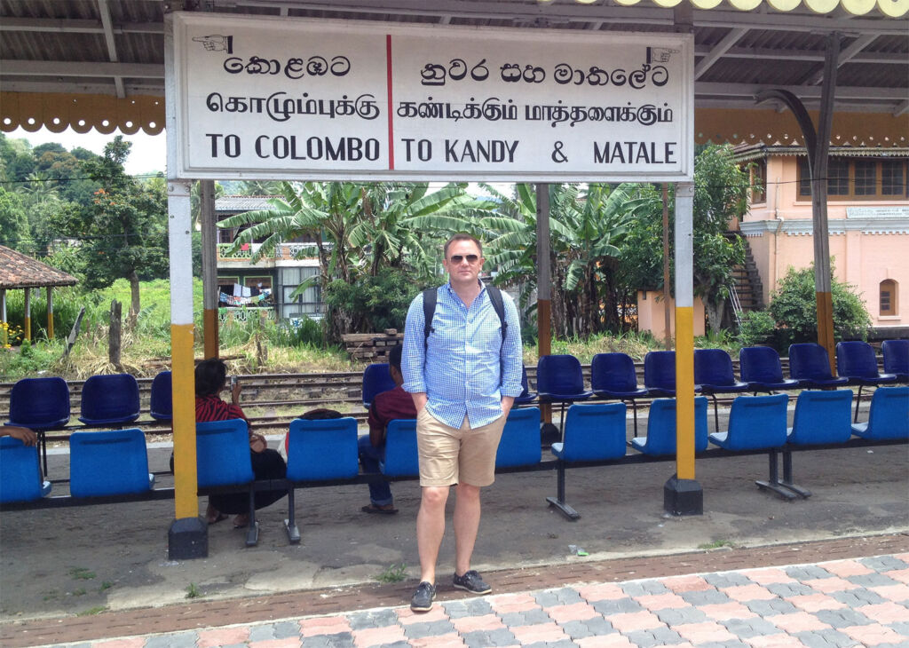 Andy Brabin at a station in India ready to go exploring