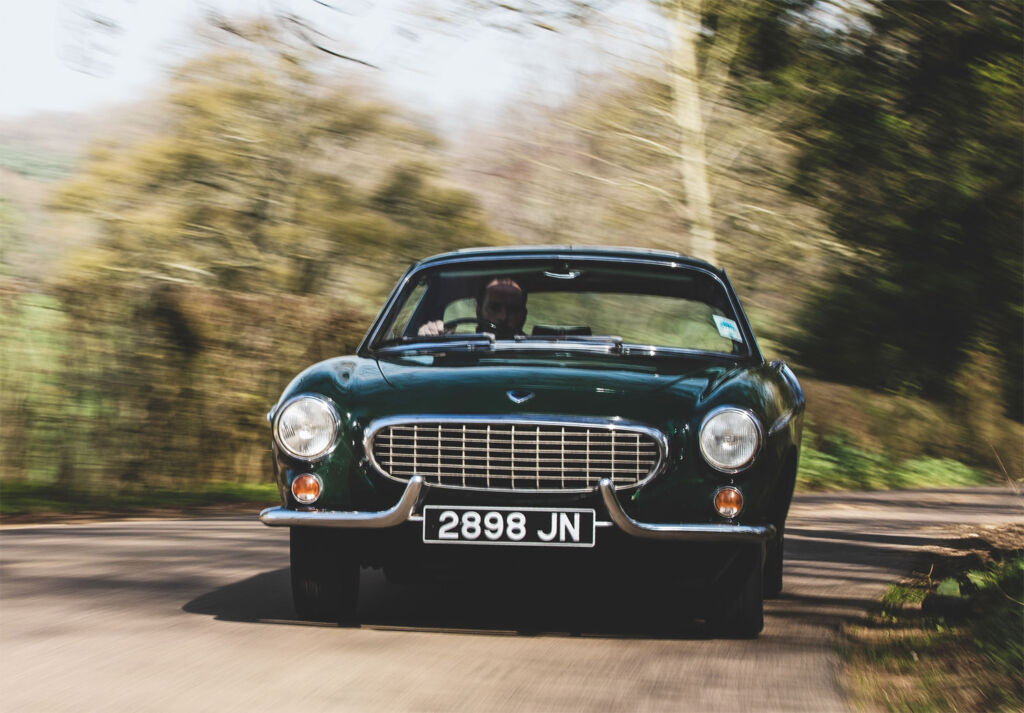 Classic Aston Martin being driven in England