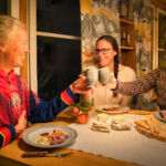 People enjoying an authentic Sami dinner