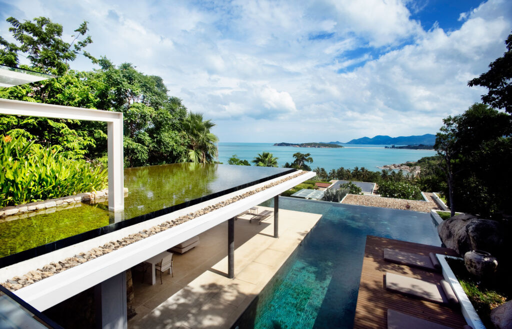 The outside terrace and infinity pool at the Samujana