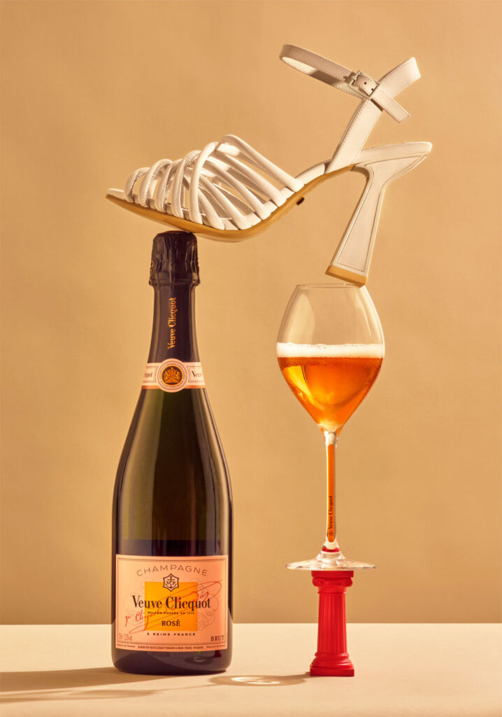 A Kat Maconie shoe blancing on a bottle of Veuve Clicquot